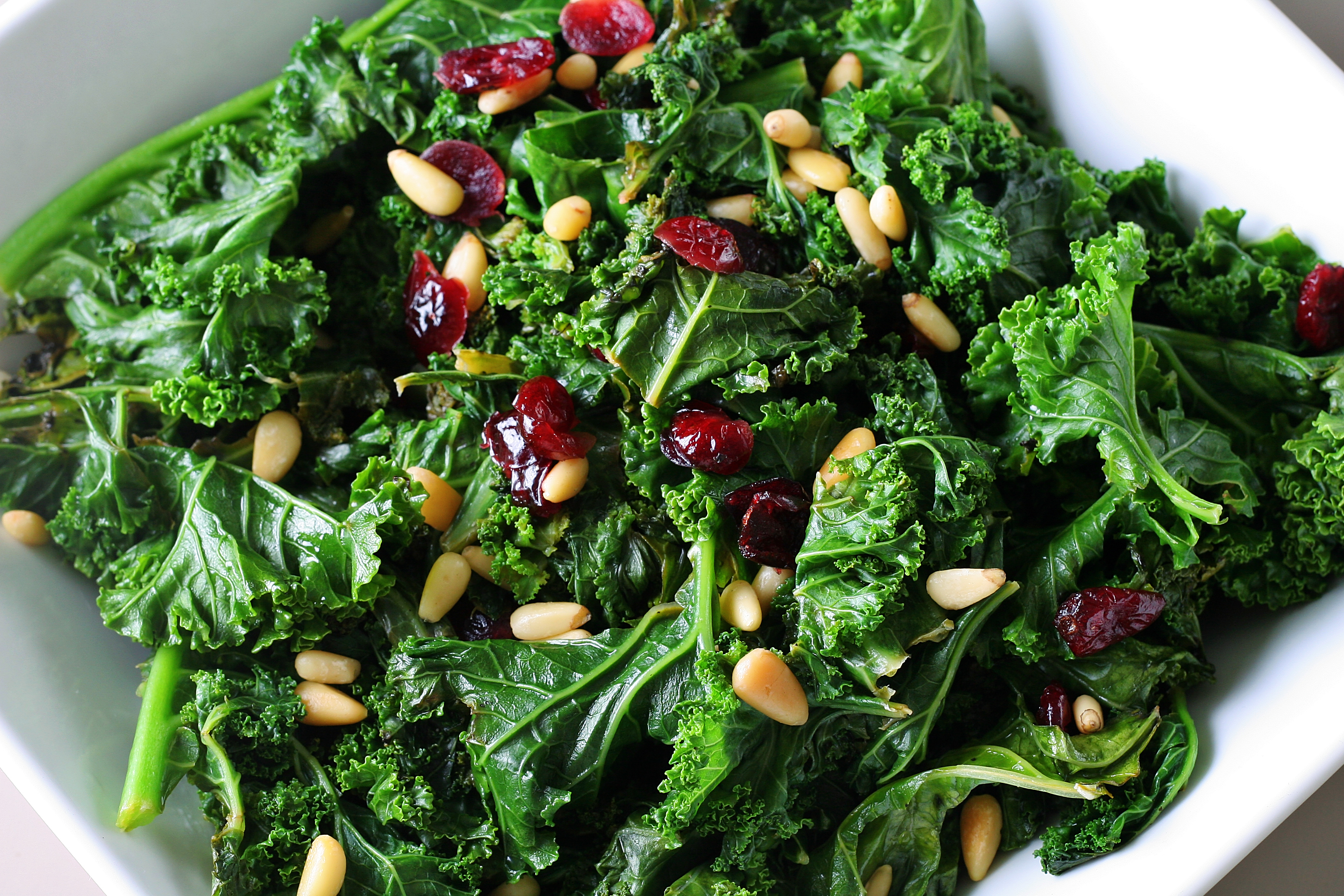 shot of sauteed kale with cranberries and pine nuts